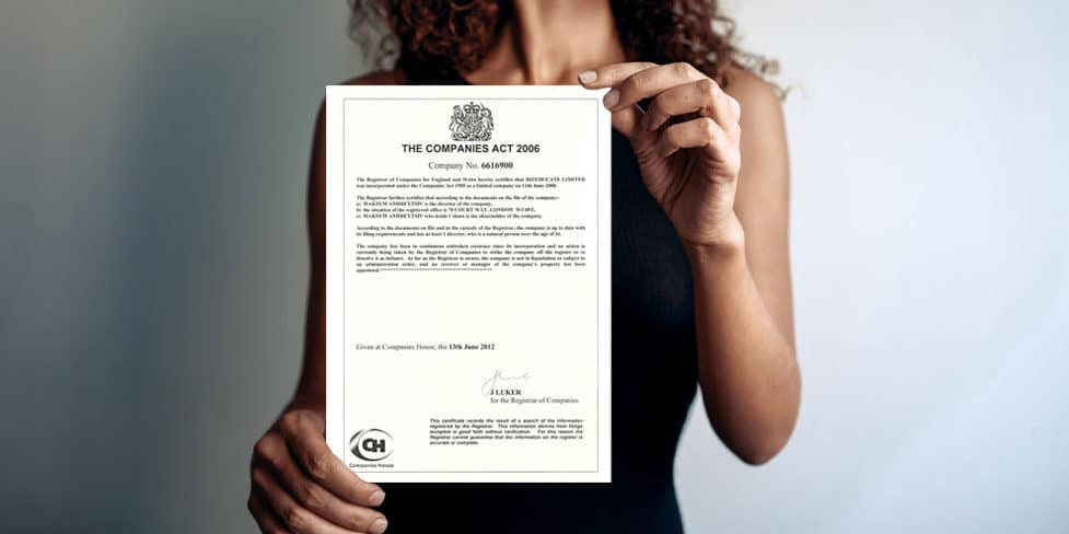 Image of a woman dressed in smart attire, holding a Certificate of Good Standing