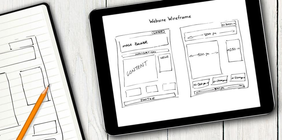 Image on an iPad displaying a hand-drawn sketch of a web page layout.