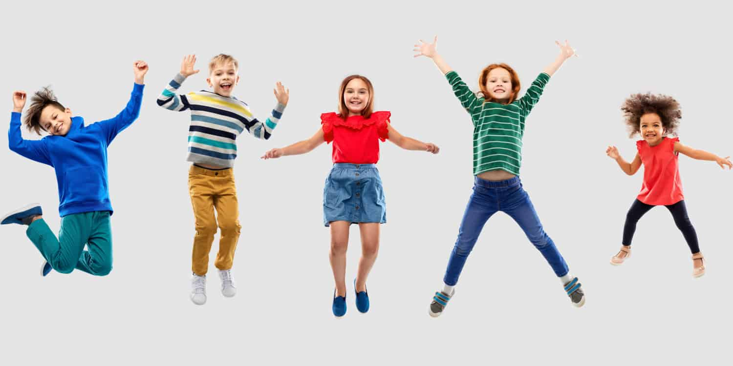 Five children jumping in the air, illustrating the concept of wanting to transfer shares to your children