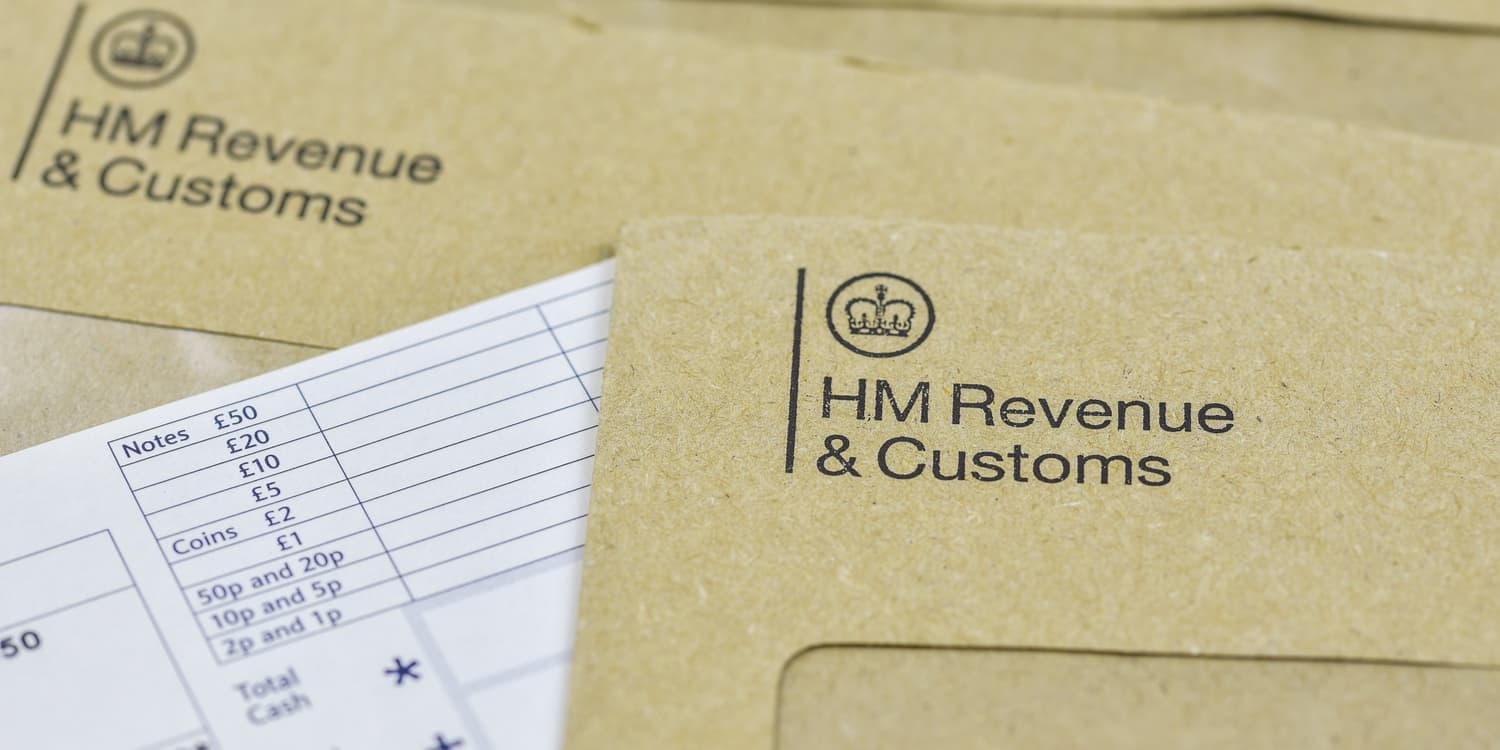 Official mail and brown envelopes featuring the HMRC logo, representing the type of correspondence that is delivered to a registered office address.
