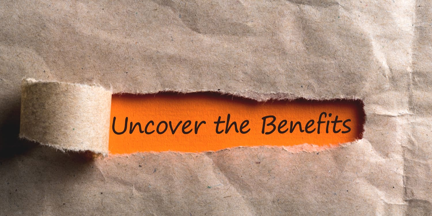 The statement 'Uncover the Benefits' being revealed with the peeling back of a manila envelope.
