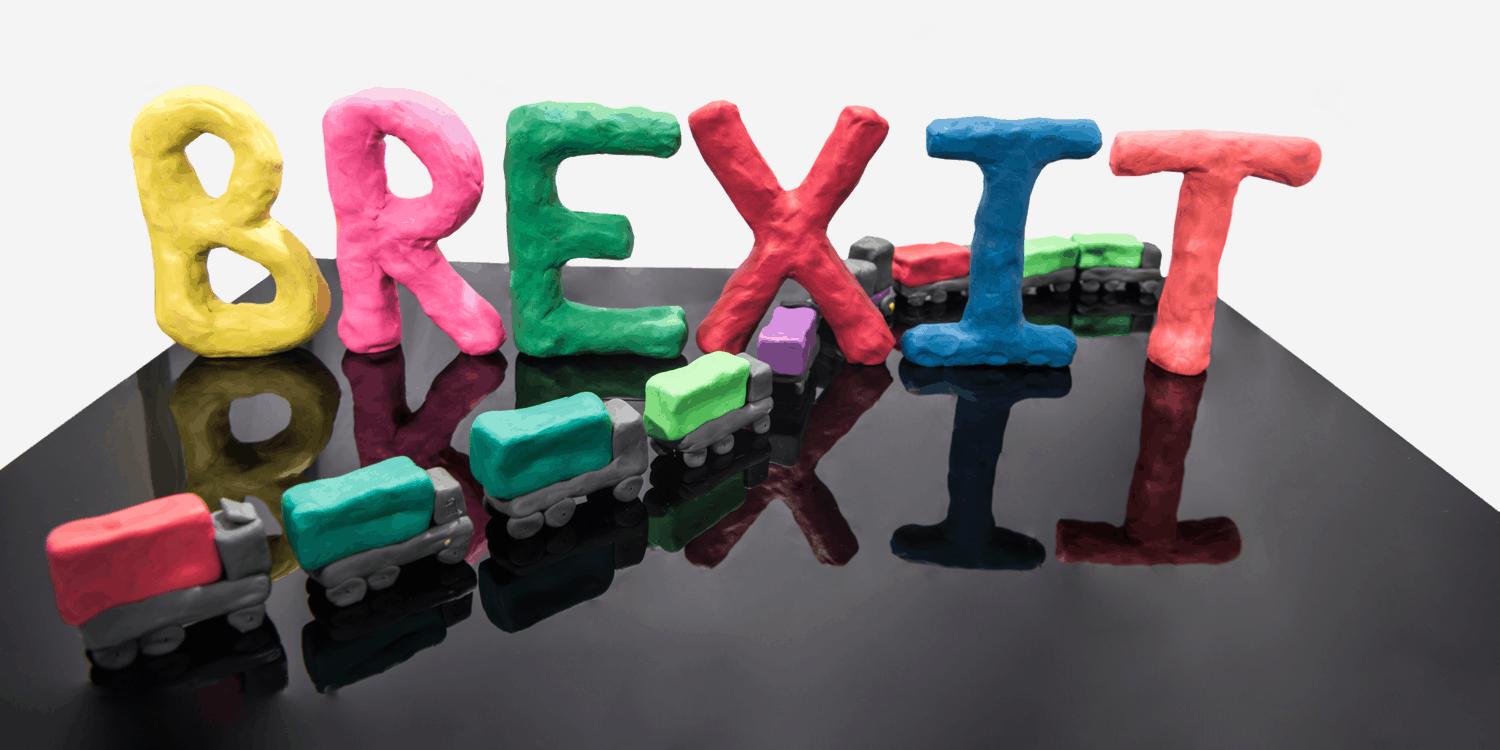 Abstract image of the word BREXIT and a line of trucks made out of Plasticine.