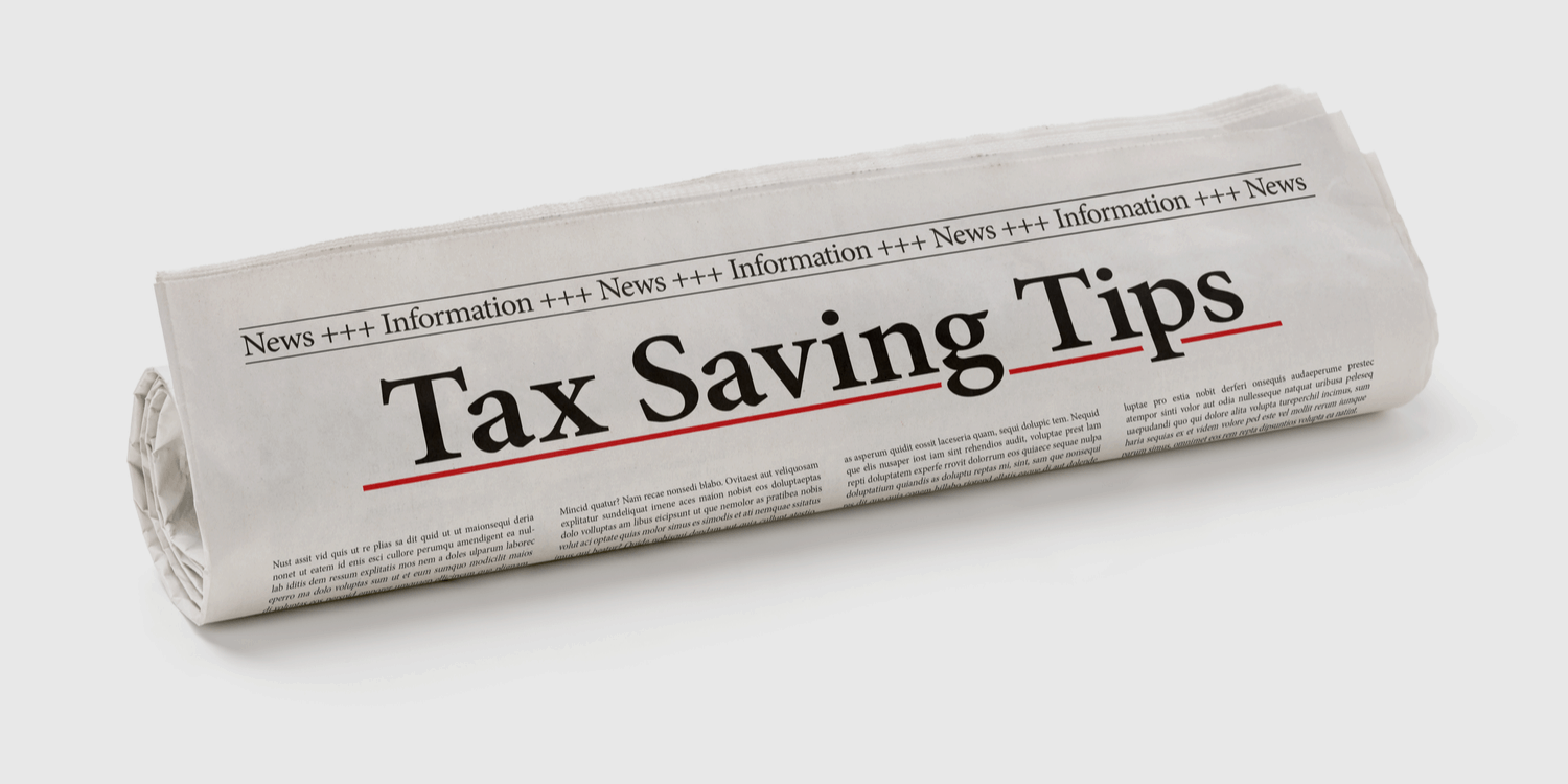 Rolled up newspaper with the heading Tax Saving Tips.