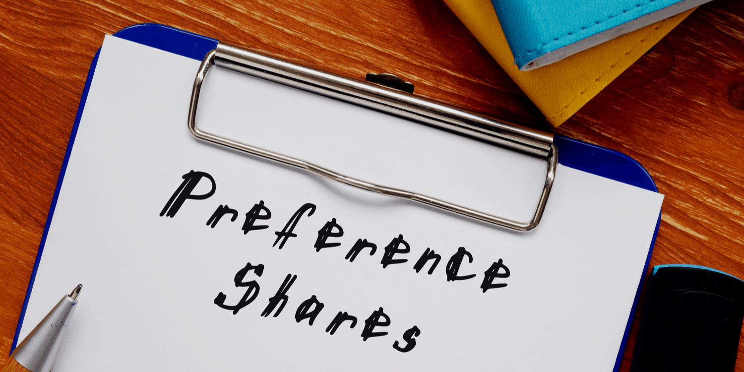 White sheet of paper held in a clipboard with the heading 'Preference Shares'