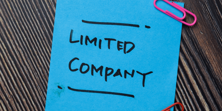 Blue 'post-it' note with the words LIMITED COMPANY in black marker pen.