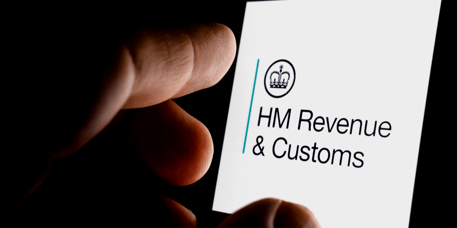 Mobile telephone screen displaying the HM Revenue & Customs' with government crown logo.