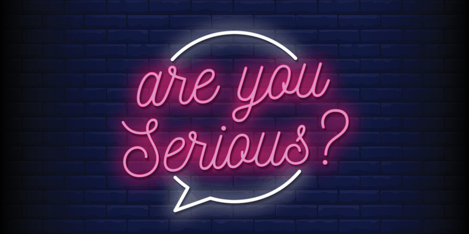 Pink neon sign with black brick background - 'are you Serious?'