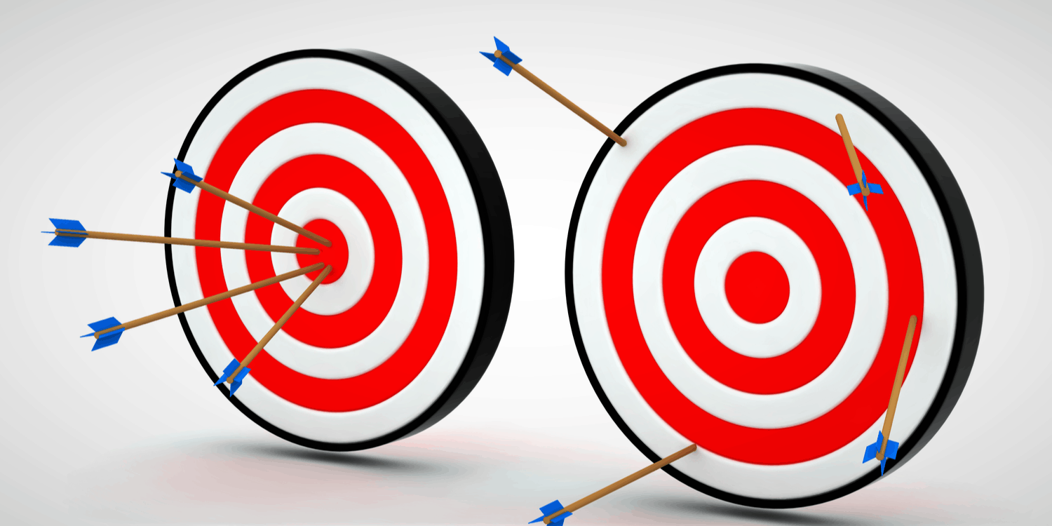 2 red and white archery targets. One with 4 arrows in the bullseye and one with 4 arrows hitting the outer circle.