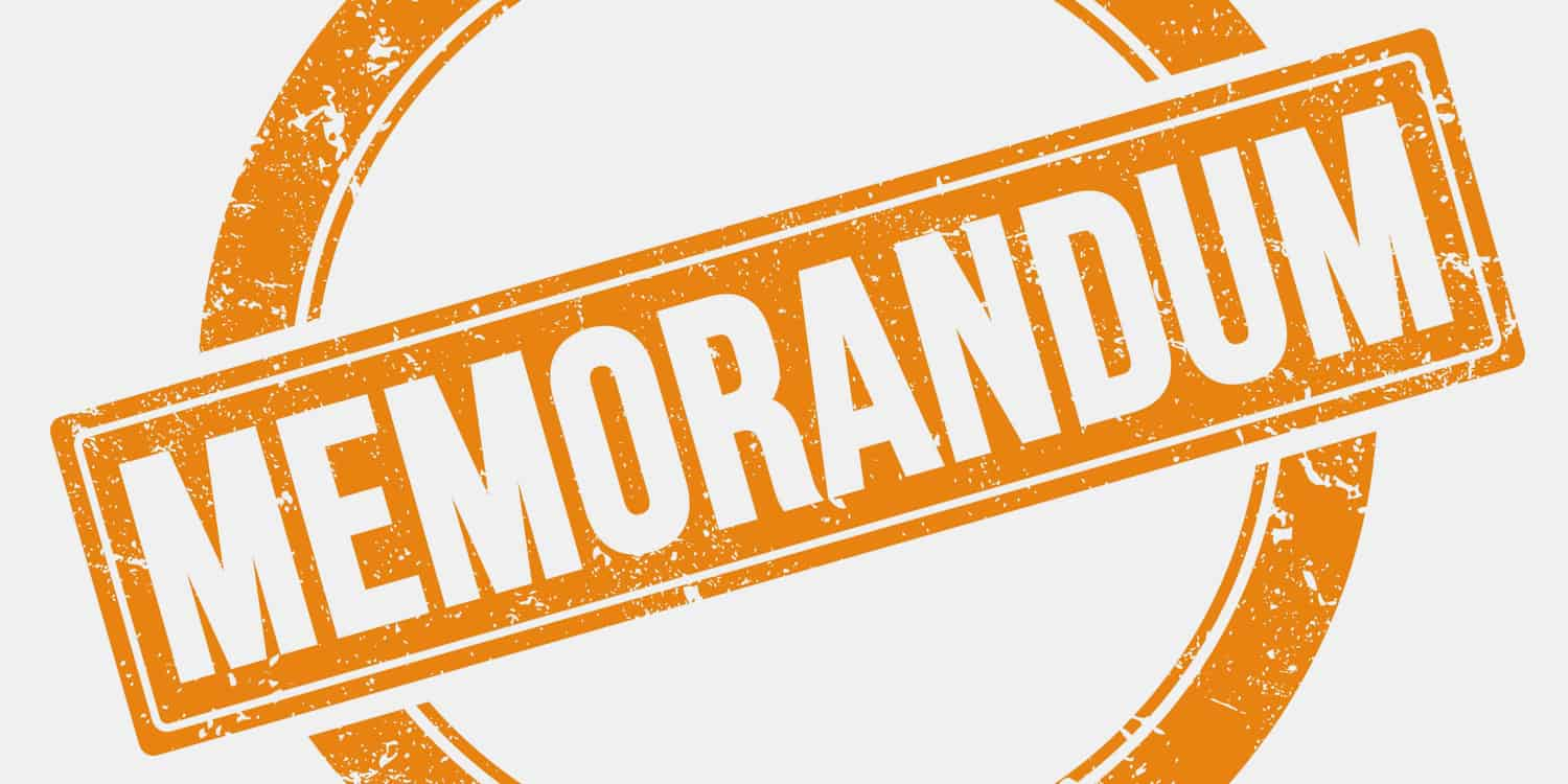 Illustration displaying the word MEMORANDUM created by a stamp in orange ink with white background.