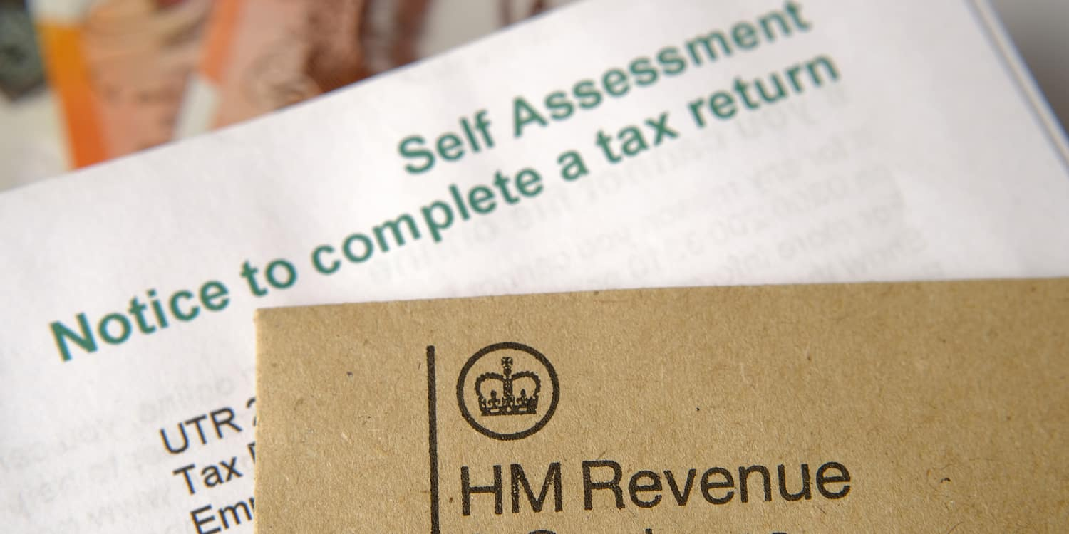 Image of Self Assessment tax return form and HMRC brown envelope.