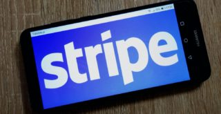 """Smartphone displaying the word """"stripe"""" in large white text against a blue background."""